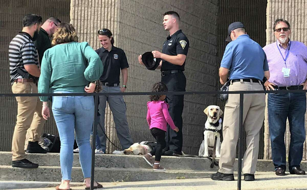 Police officers and canines outide the New Haven Police Department in honor of New Haven Officer Joshua Castellano, who was killed in a crash in Las Vegas on Sept. 17, 2021.
