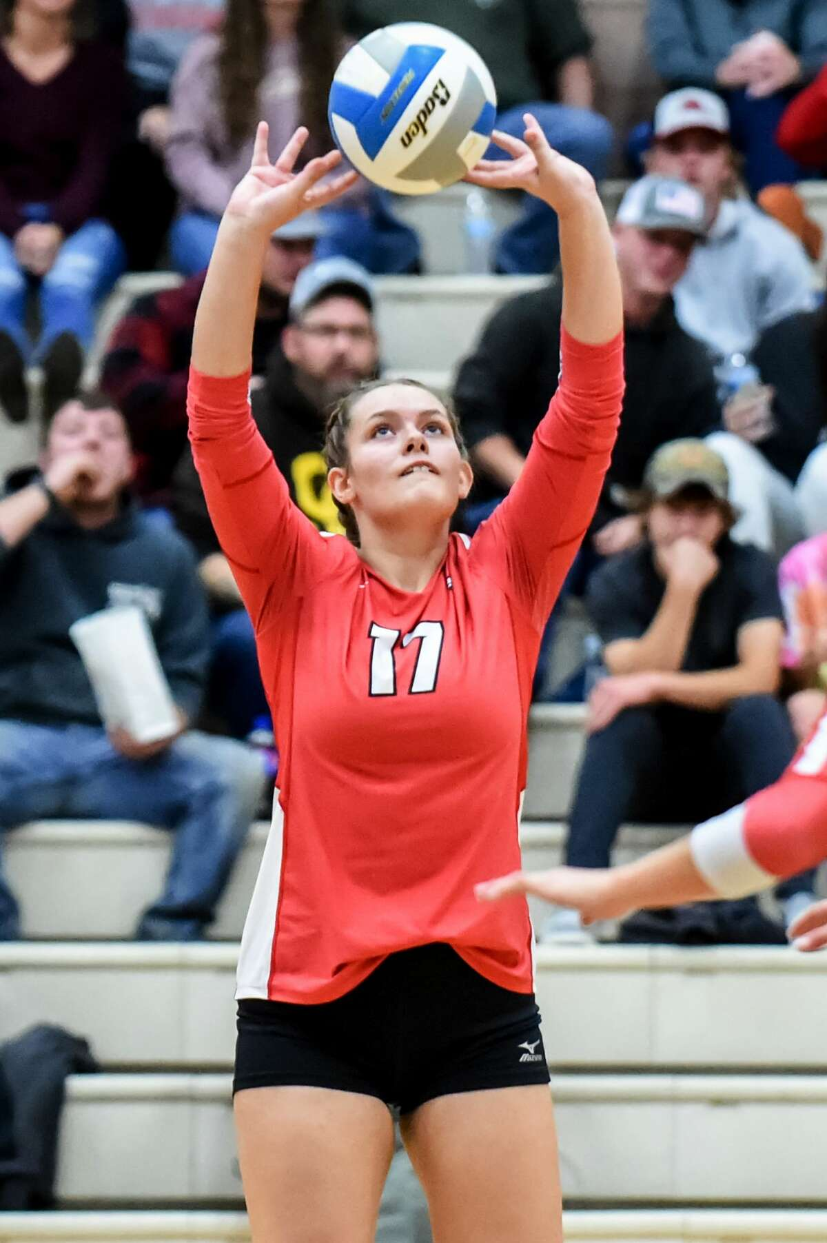 Beaverton's Kaelyn Fischer sets the ball during Wednesday's match against Clare, Sept. 22, 2021.