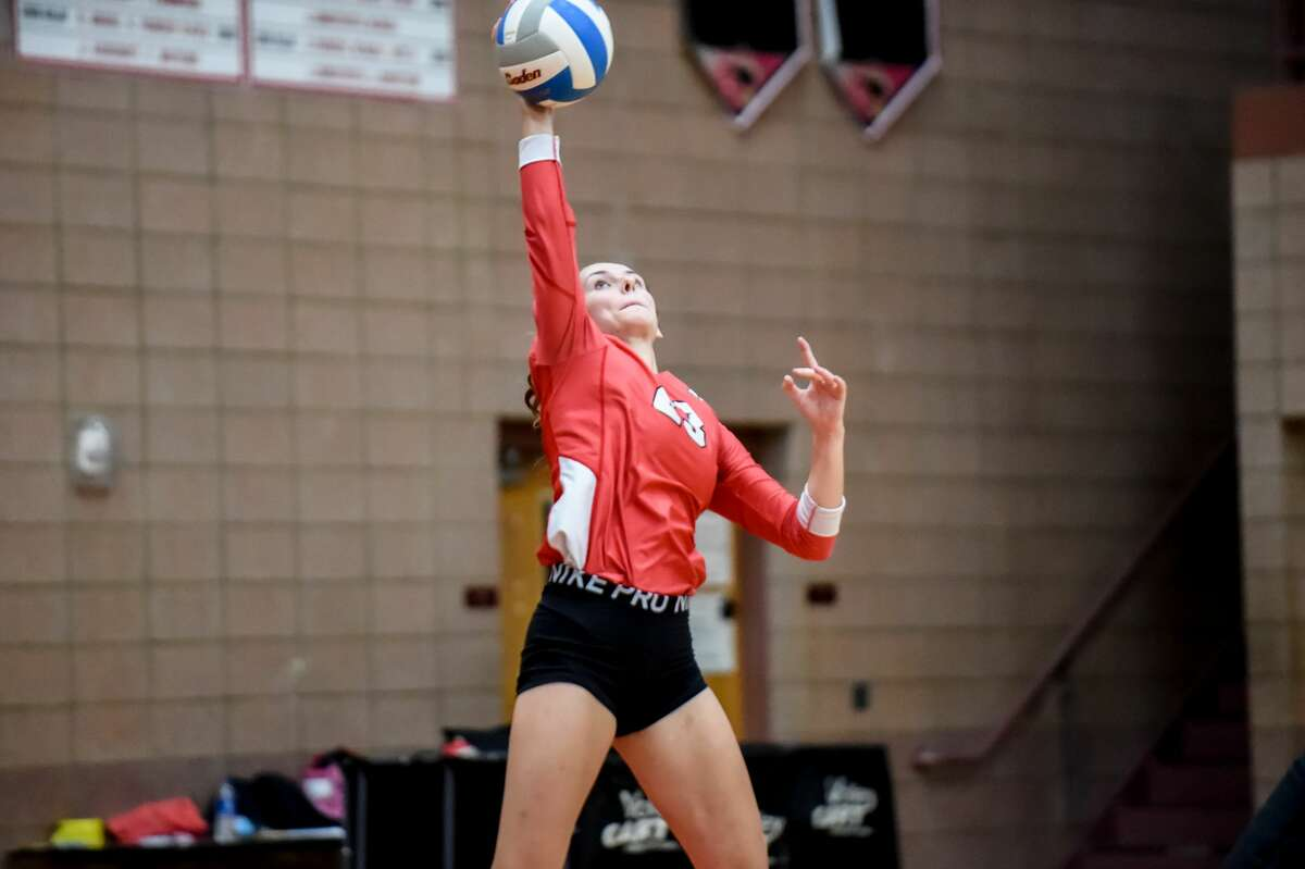 Beaverton's Hannah Stearns serves the ball during Wednesday's match against Clare, Sept. 22, 2021.