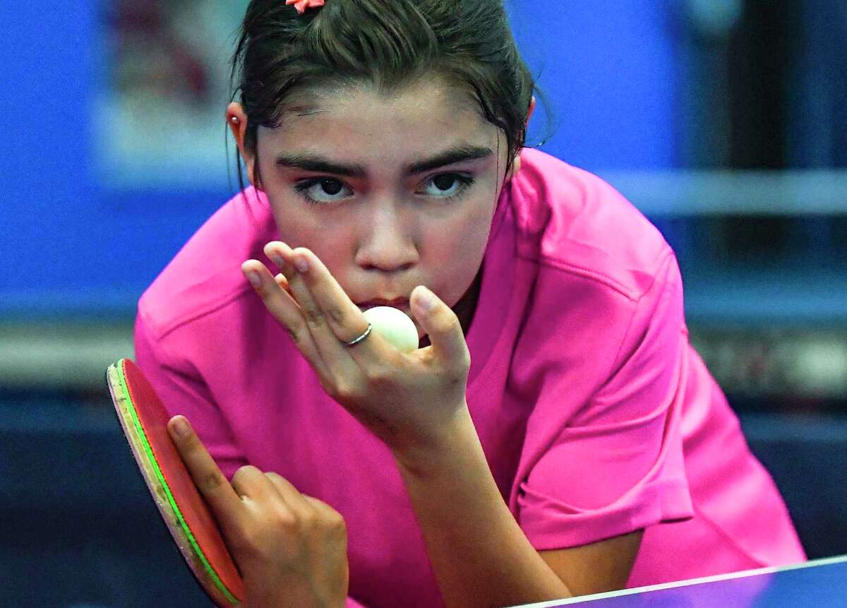 Eleven-year-old Lia Morales, a student at Harlandale Middle School, prepares to serve at the San Antonio Table Tennis Club on Monday, Sept. 20. She is a rising star in the world of table tennis, ranked No. 13 in the nation among 13 and under players.