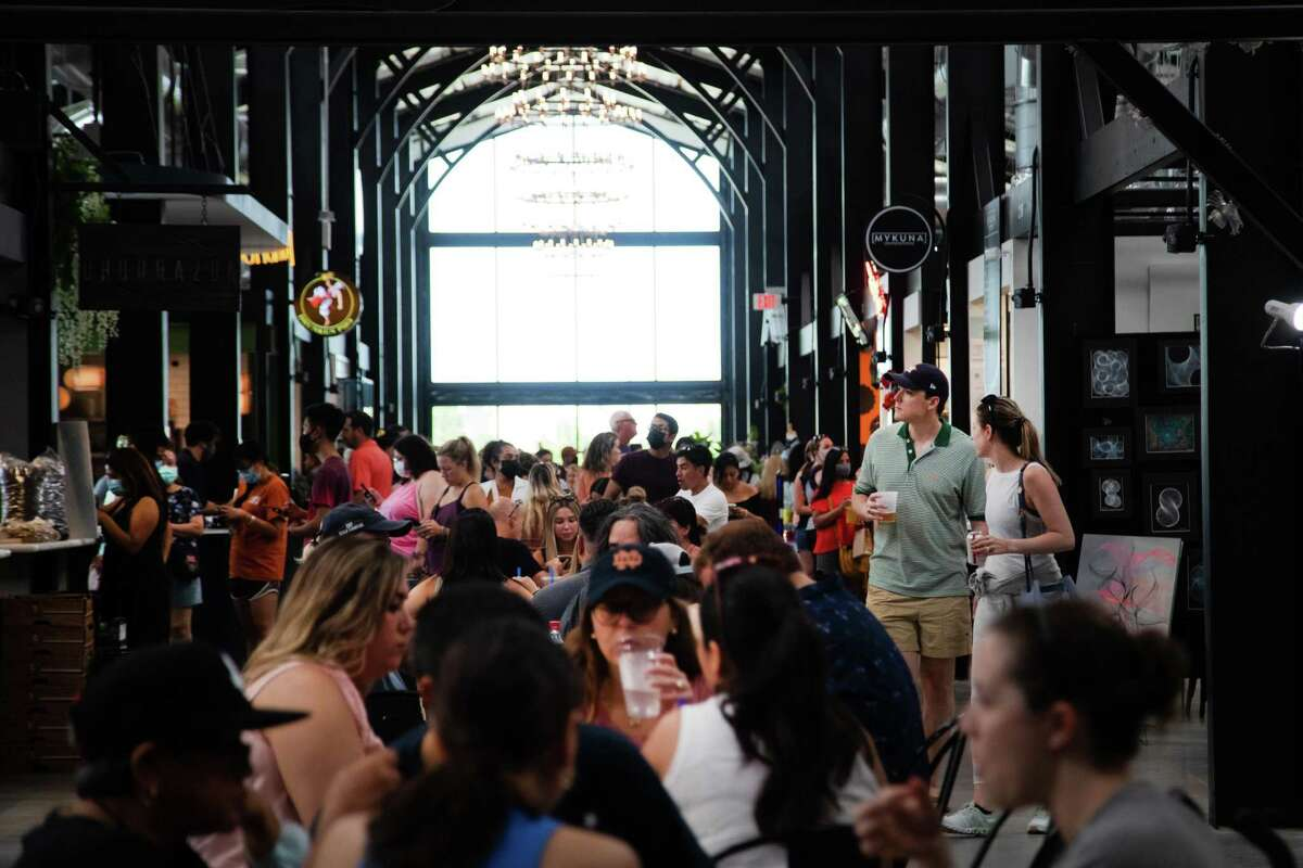 A crowd gathers at the Railway Heights Market to visit the new venue in Houston on Aug. 21.