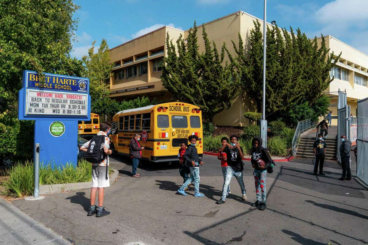 Students leave campus for the day at Bret Harte Middle School in Oakland on Tuesday. Oakland's school district has mandated vaccines for eligible schoolchildren.