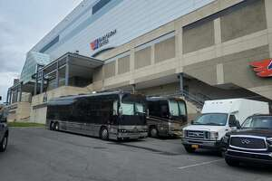 Instead of being parked outside the Palace Theatre on Thursday, Sept. 23, 2021, tour buses for the band AJR sit about eight blocks south, also on Pearl Street, outside the Times Union Center. With only two days' notice, the band requested to switch venues to accommodate parts of its show that wouldn't have fit inside the Palace.