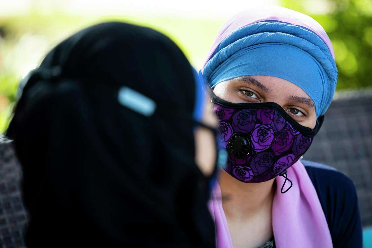 Raheemah Ali listens to her sister, Fatimah, a shopping area on Saturday, Sept. 18, 2021.