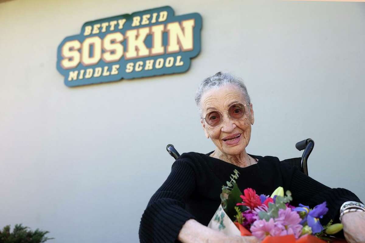 Betty Reid Soskin, the oldest full-time National Park Service ranger in the United States, sits in front of a sign during a Wednesday ceremony for the newly renamed Betty Reid Soskin Middle School in El Sobrante.