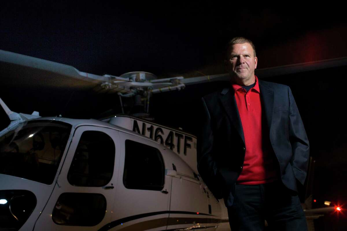 Tilman Fertitta stands for a portrait next to his helicopter on his way out of Landry's Corporate Office, Thursday, Nov. 17, 2016, in Houston. ( Marie D. De Jesus / Houston Chronicle )