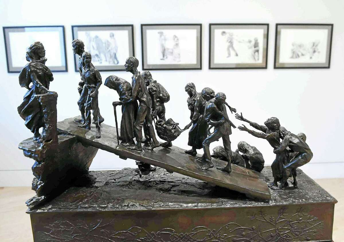 """The sculpture """"The Leave-Taking"""" by Margaret Lyster Chamberlain at Ireland's Great Hunger Museum at Quinnipiac University in Hamden in 2016."""