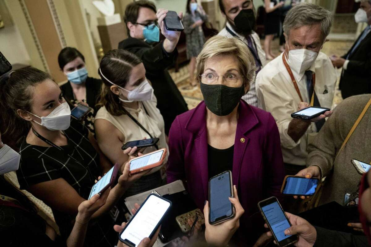 Sen. Elizabeth Warren, a Democrat from Massachusetts, speaks to members of the press following a weekly Democratic caucus luncheon at the U.S. Capitol in Washington, D.C., on Sept. 21, 2021.
