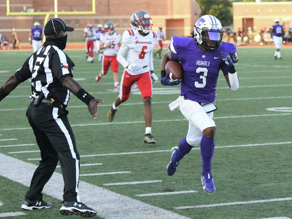 Humble senior wide receiver Trevon McCray scores a touchdown aagisnt Aldine MacArthur in a non-district game at Turner Stadium.