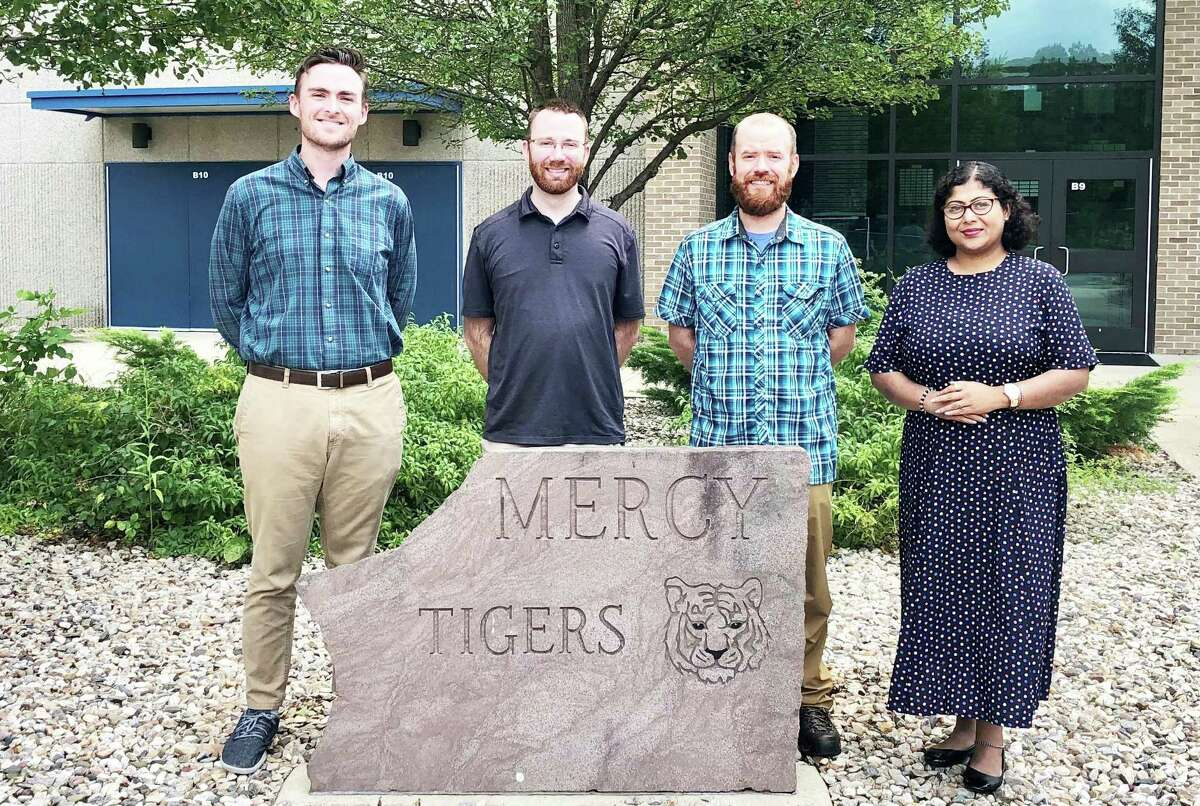 The new members of the Mercy High School faculty include, from left, Liam Cahill, English; Justin Michaud, math; Andrew Carroll, social studies and world languages (Latin); and Sangita Ray, science (physics).