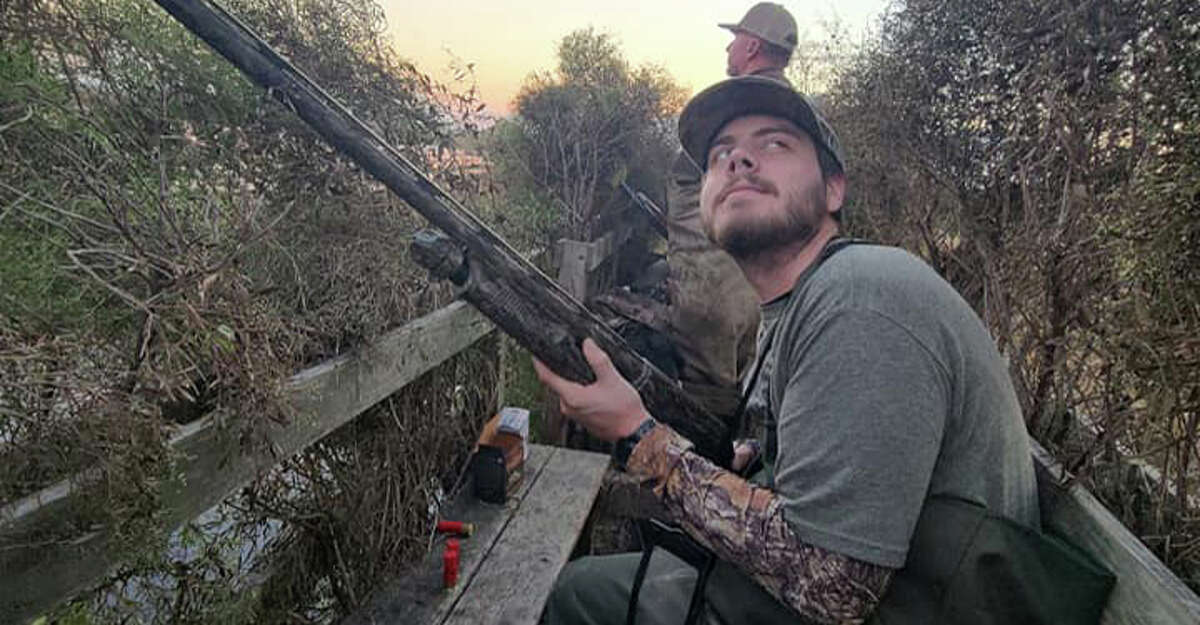 The author's brother, Andrew, braces for an incoming flock of blue-winged teal while hunting a rice field in Anahuac with guide Jason Catchings.