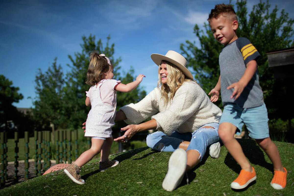 Kelly Stanfield, 36, plays with her daughter Teddy Stanfield, 2, and her son Van Stanfield, 4, at a park near their home in Cypress, Wednesday, Sept. 22, 2021. Stanfield delivered her son Kitt Stanfield after only 27 weeks during an emergency caesarean section while Kelly was hospitalized with pneumonia due to COVID-19.