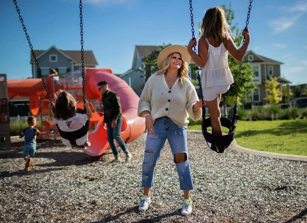 Kelly Stanfield, 36, plays with her daughters Teddy Stanfield, 2, and Kai Stanfield, 7, at a park near their home in Cypress, Wednesday, Sept. 22, 2021. Stanfield delivered her son Kitt Stanfield after only 27 weeks during an emergency caesarean section while Kelly was hospitalized with pneumonia due to COVID-19.
