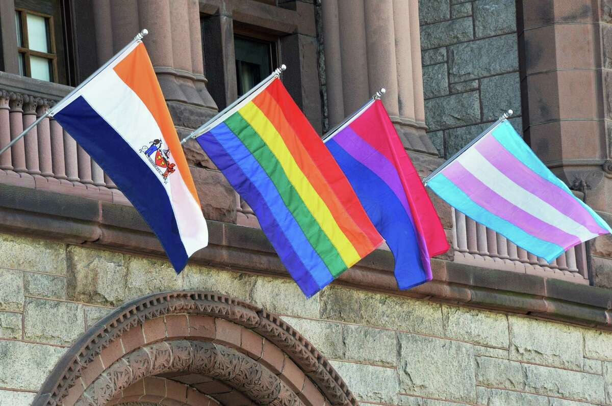 A reader says the original rainbow Pride flag is symbolic of a melting pot and other groups don't need their own flags. Here, rainbow flags fly over City Hall in Albany, N.Y.