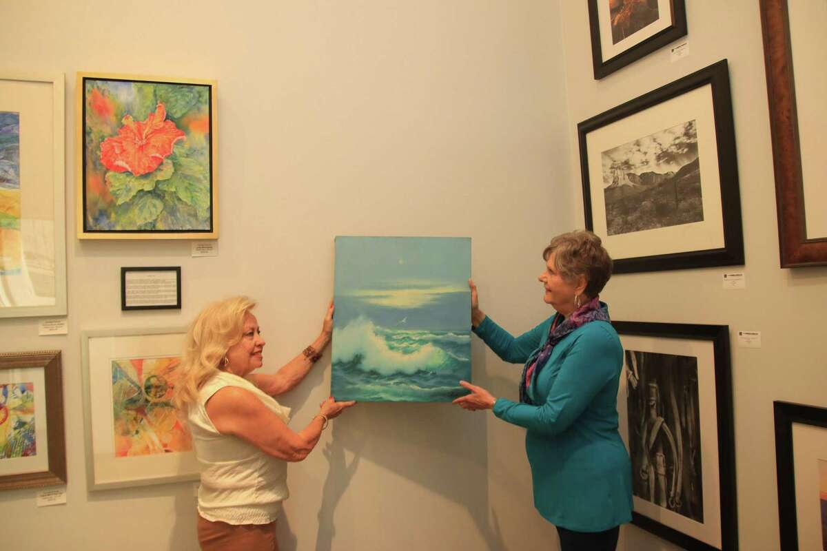 The new gallery for the Pearland Arts League features the works of 25 artists. Naomi Stevens, left, and Margo Green prepare the gallery for a grand opening at 5 p.m. Sept. 24 to which the public is invited. The gallery is in the Pearland Town Center, 11200 Broadway St., Pearland, in Suite 1380 near the pavilion.