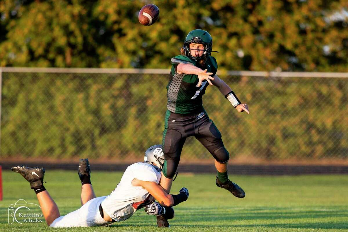 Laker quarterback Connor McCain throws a pass. (Kaitlin Gunsell of Kaitlin's Klicks/For the Tribune)