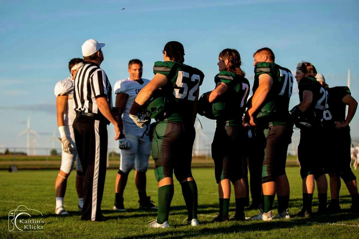 Laker players line up for the coin toss against Cass City. (Kaitlin Gunsell of Kaitlin's Klicks/For the Tribune)