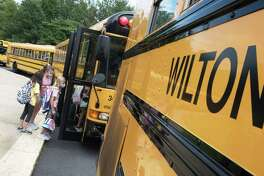 Cider Mill Students head to their buses after the first day of school on Monday, August 30, 2021, in Wilton, Connecticut