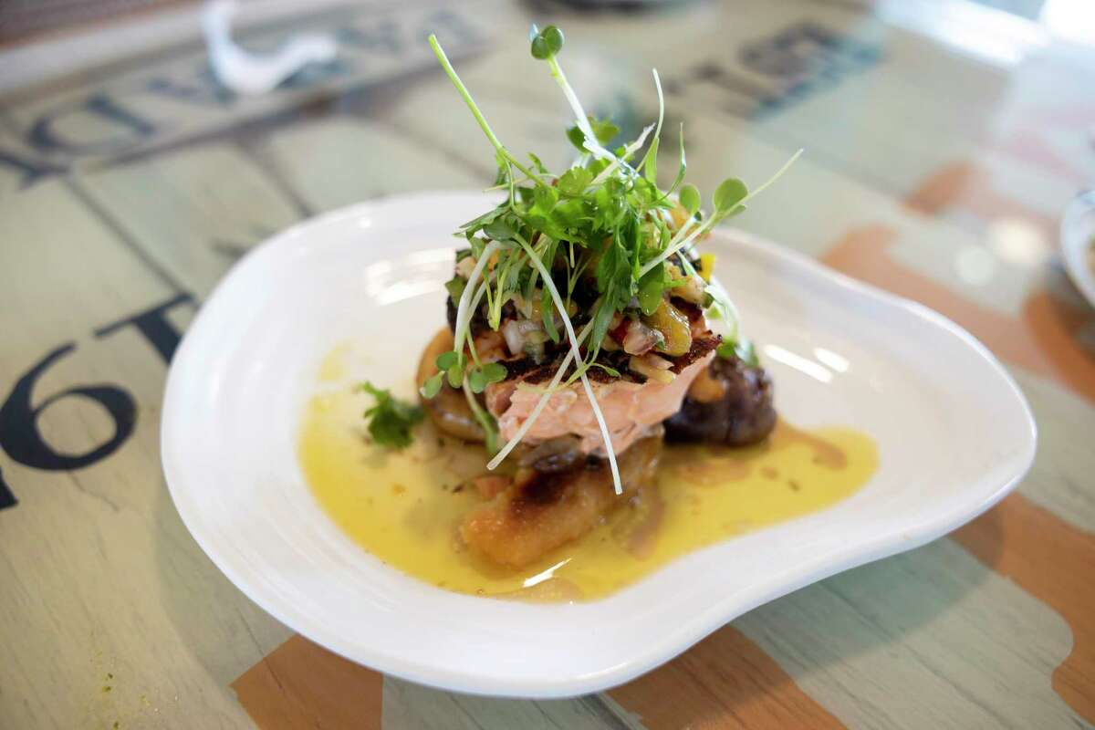 The Jerk Salmon dish is plated at Margaritaville, Wednesday, Sept. 15, 2021, in Lake Conroe. A new menu was launched for License to Chill two weeks ago.