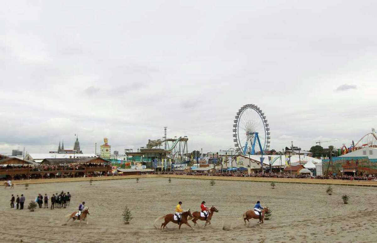 MUNICH, GERMANY - SEPTEMBER 17: Jockeys race with horses during the opening ceremony of the 'Historical Wiesn' on September 17, 2010 in Munich, Germany. 2010 marks the 200th anniversary of Oktoberfest. The Oktoberfest dates from 1810. The original Fest was the celebration of a royal Bavarian wedding. Princess Teresa (Therese) of Bavaria (1792-1854) had married crown prince Ludwig I (later king of Bavaria) on the evening of October 12, 1810. The next day, the city began celebrating the wedding with various activities, including concerts, parties, balls, and even a horse race on the 17th. It all went so well that the Bavarian royal family decided to hold another race a year later, beginning the Oktoberfest tradition. (Photo by Miguel Villagran/Getty Images)