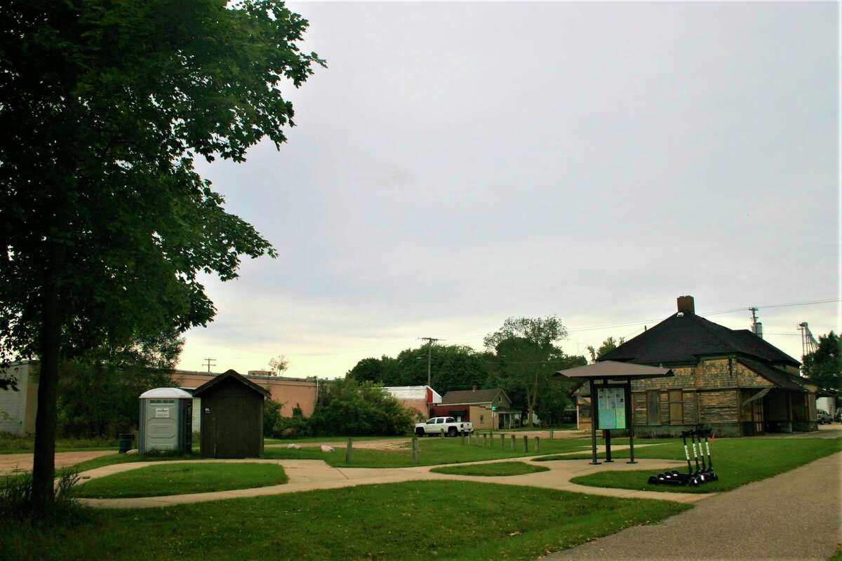 The city of Big Rapids is in the process of acquiring property south of the Depot building along the White Pine Trail trailhead for the purpose of establishing a public outdoor recreation area. (Pioneer photo/Cathie Crew)