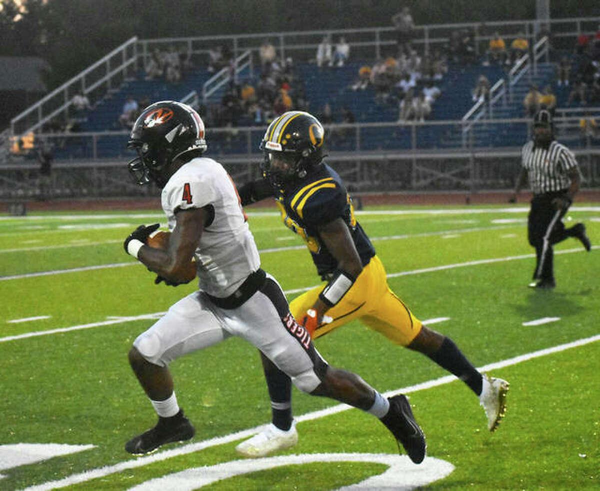 Edwardsville wide receiver Kellen Brnfre hauls in a 75-yard touchdown reception in the first quarter.