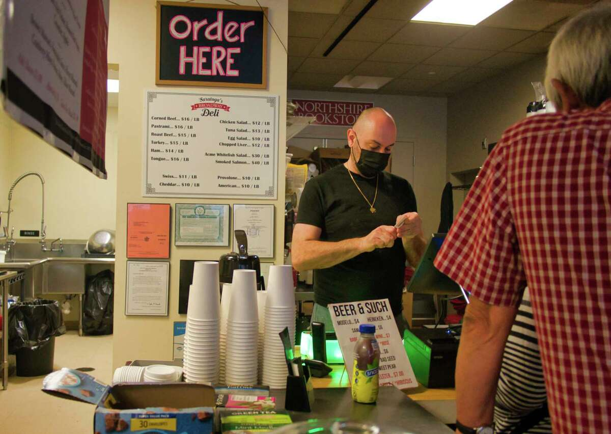 Daniel Chessare, owner of Saratoga's Broadway Deli, takes care of customers at his restaurant on Thursday, Sept. 23, 2021, in Saratoga Springs, N.Y.