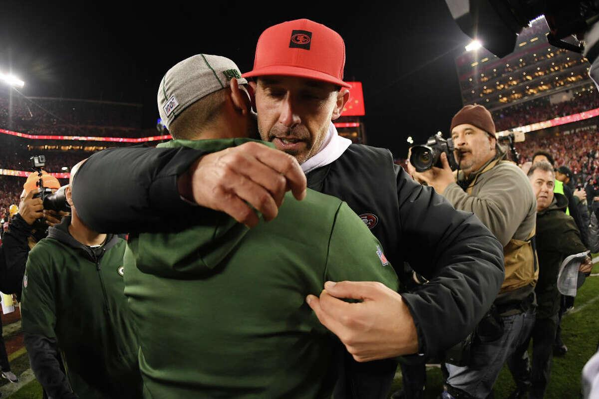 Head coach Kyle Shanahan of the San Francisco 49ers hugs head coach Matt LaFleur of the Green Bay Packers