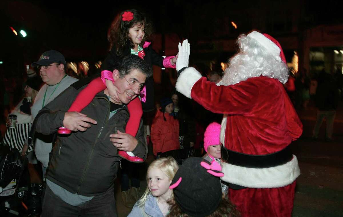Emilia Santo Domingo of New Canaan greets Santa as he arrives to Old Greenwich First Light in 2015. The event is slated to return on Dec. 4.
