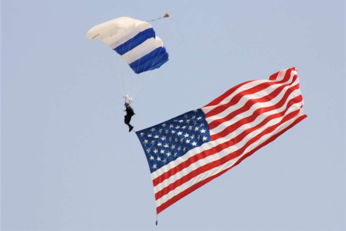 The US flag in the U.S. Air Force Academy Wings of Blue Jump team opening the flying Ceremony.