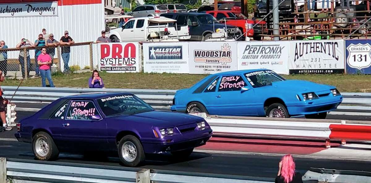 A special tribute pass was made during last Saturday's event at NMD. Emily Orth's purple Mustang was driven by her brother Devin Orth of Traverse City, while Dan Snyder of Houghton Lake drove Devin's car. (Courtesy photo)