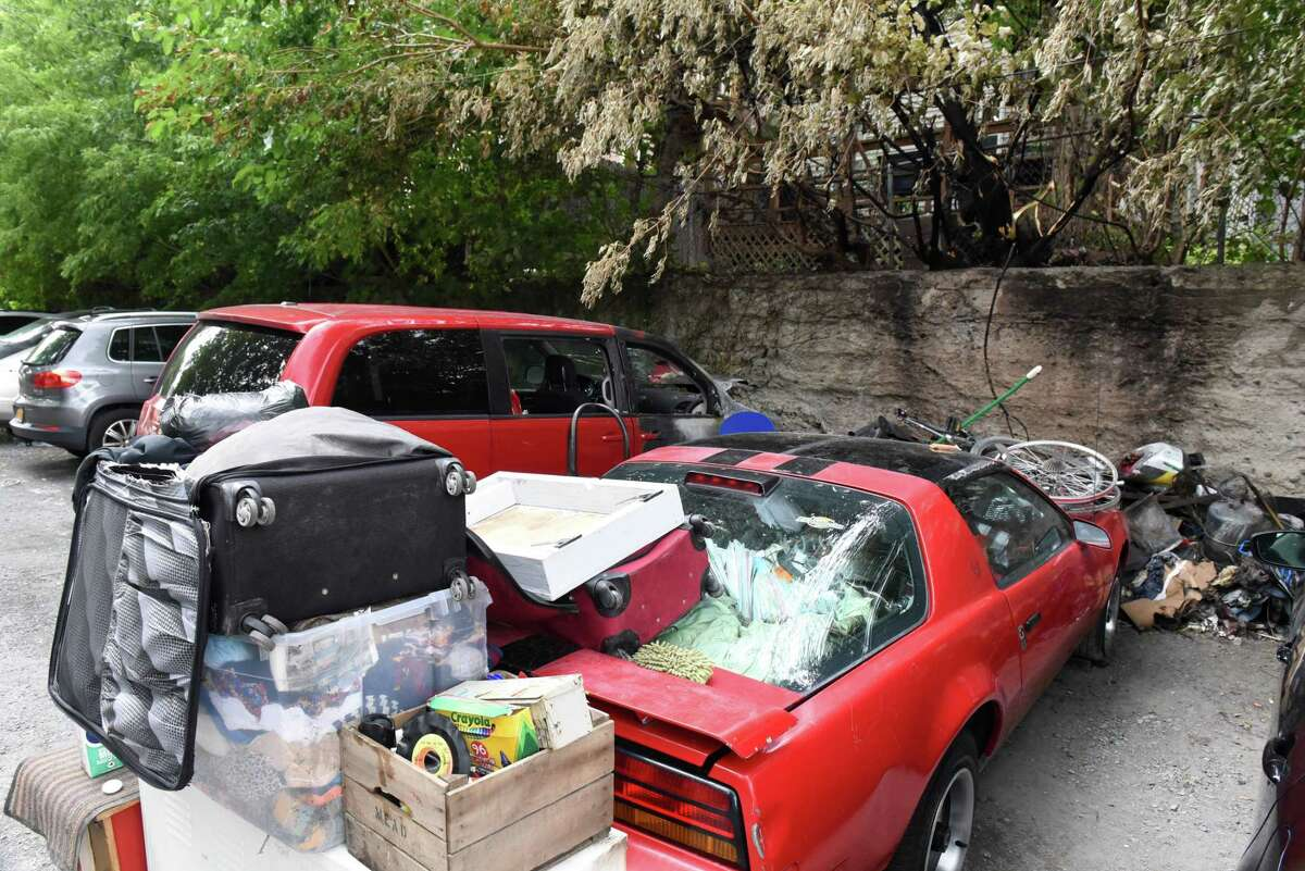 Abandoned cars and trash are part of the landscape in an alleyway off Knox Street between Myrtle Ave. and Morris Street on Thursday, Sept. 23, 2021, in Albany, N.Y. The area also serves as a parking space for nearby apartments.