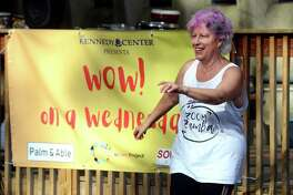 Robin Allen, exercise, arts and facilities coordinator, leads a dance session during the Kennedy Center's first Wow on a Wednesday program, in Trumbull, Conn. Sept. 22, 2021.