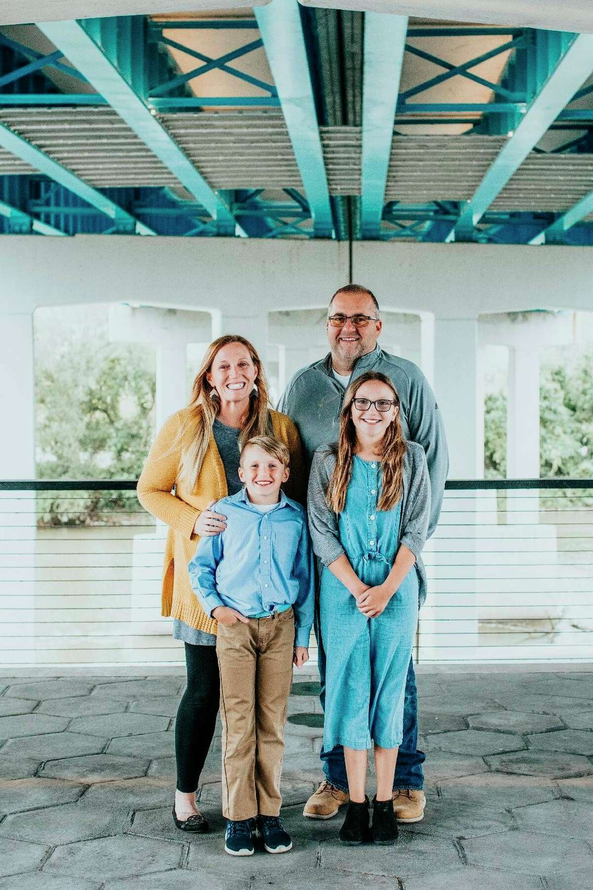 Beginning a new church in Sanford as a family are,clockwise from top left, Jamie Engler, John Engler and their children, Isabelle and Jackson. The church is called ONECHURCH and its first service is expected to be inlate October.
