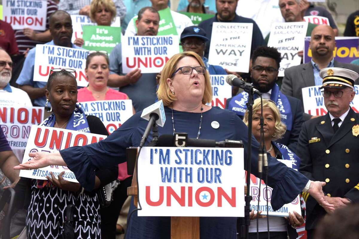 Kate Dias, a math teacher and president of the Manchester Education Association, speaks during a press conference after the U.S. Supreme Court on Janus v. AFSCME on June 27, 2018, in Hartford, Conn.