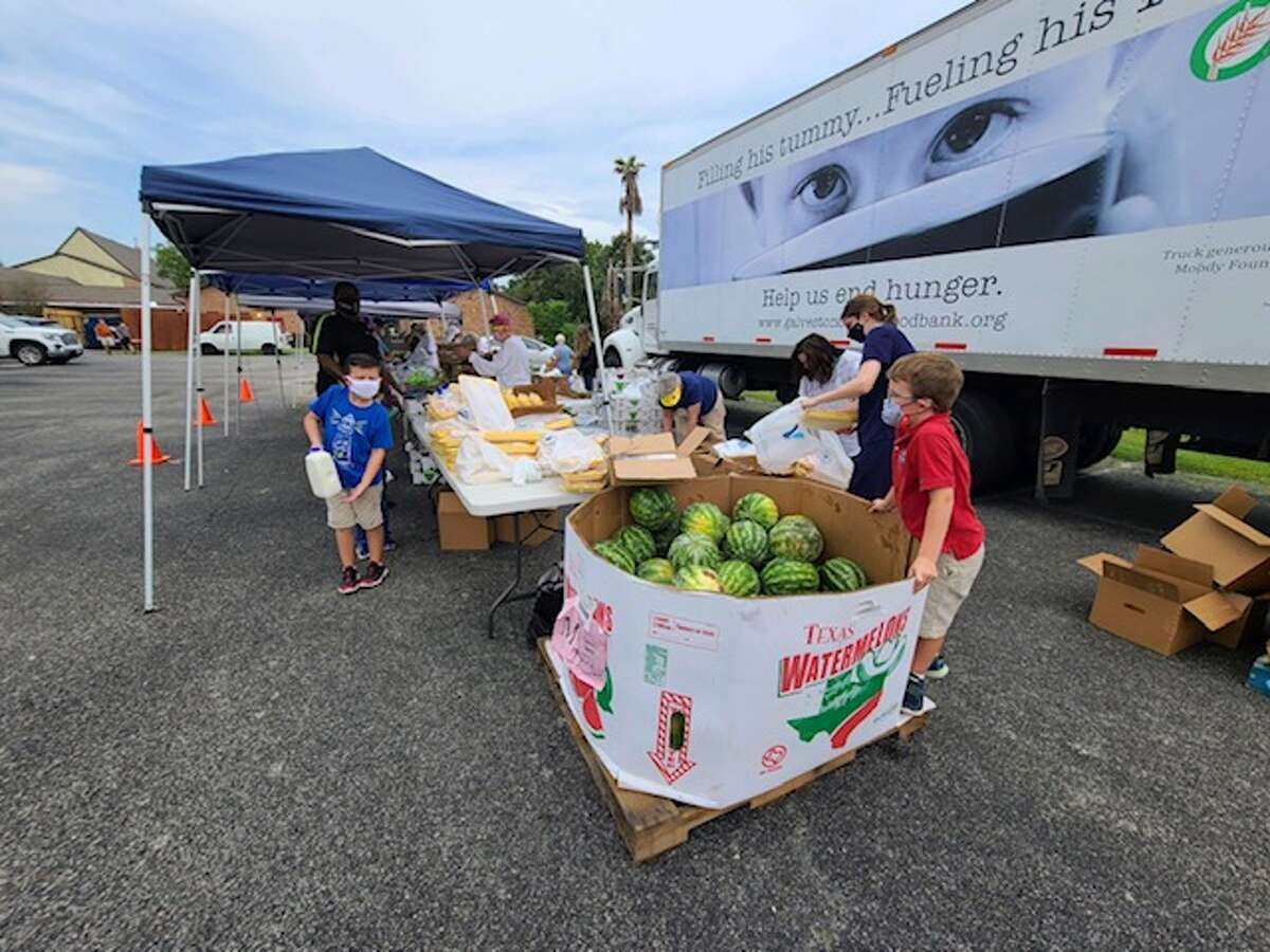 Volunteers distribute fresh fruits, vegetables, meat and hygiene items at a recent food drive coordinated by St. Thomas the Apostle Episcopal Church and the Galveston Food Bank. The next distribution event will be 8 a.m. Oct. 2 at 18300 Upper Bay Road. Email Mike Stone, rector@sttaec.org, for details.