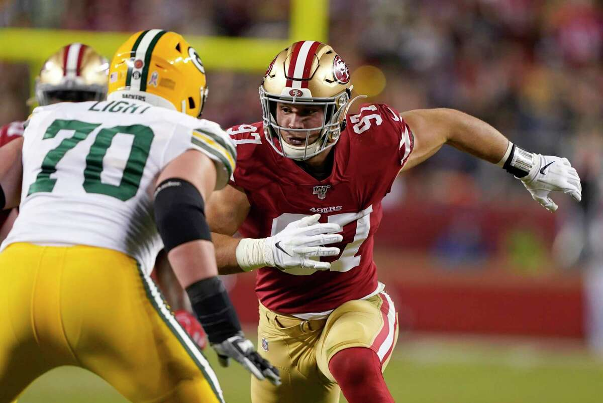 """FILE - In this Nov. 24, 2019, file photo, San Francisco 49ers defensive end Nick Bosa (97) rushes against Green Bay Packers offensive guard Alex Light (70) during the first half of an NFL football game in Santa Clara, Calif. After nearly a year-long wait, the Niners can't wait to see Bosa's dominance in a game when he returns from a knee injury in the season opener at Detroit on Sunday. He's a game wrecker,"""" linebacker Fred Warner said. """"He's one of those guys that has that ability."""" (AP Photo/Tony Avelar, File)"""