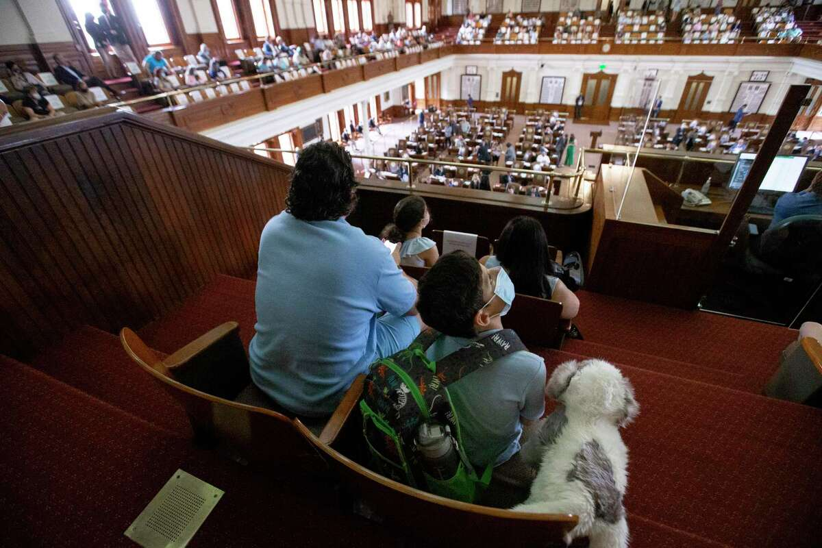 The Stanton family sits at the House Gallery at the Texas Capitol on Saturday, May 8, 2021, in Austin. The Stanton family joined a group of transgender families to speak out against bills in the legislature that will affect their lives.