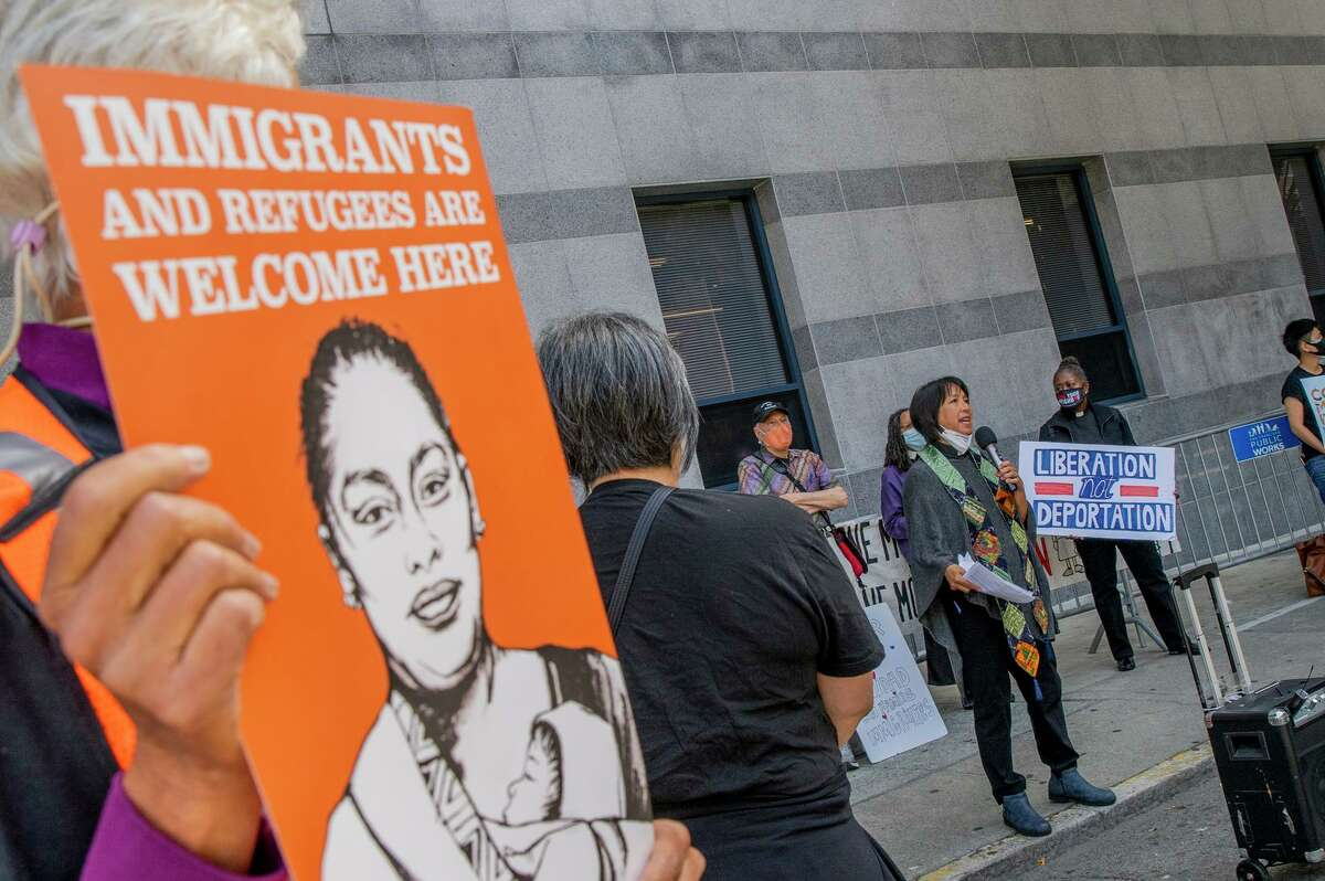 Protesters share their feelings about the treatment of Haitian refugees in Texas outside ICE headquarters in San Francisco.