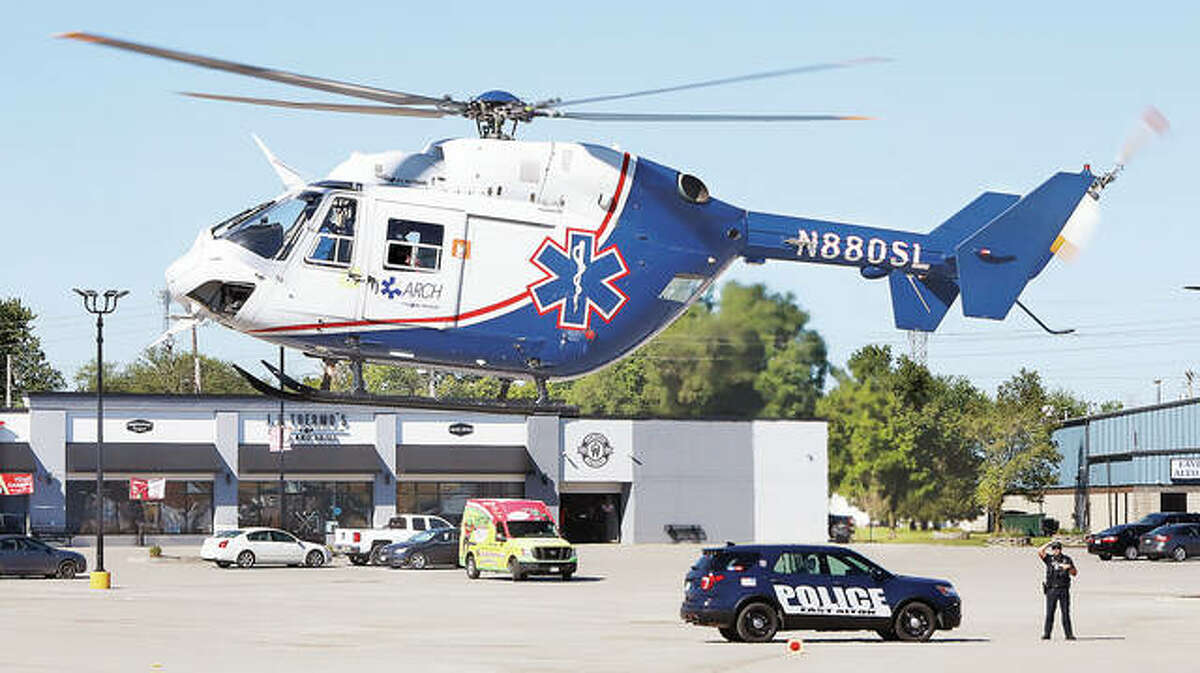 An ARCH Air Medical Services, Inc., helicopter ambulance lifts off from Eastgate Plaza Thursday morning to take an injured man to a St. Louis trauma center following a tree cutting accident.