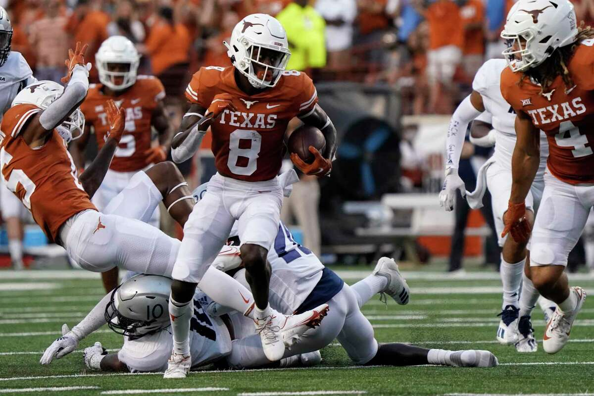 Texas wide receiver Xavier Worthy (8) runs after a catch against Rice during the first half of an NCAA college football game on Saturday, Sept. 18, 2021, in Austin, Texas. (AP Photo/Chuck Burton)