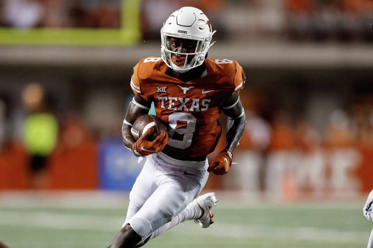 AUSTIN, TEXAS - SEPTEMBER 18: Xavier Worthy #8 of the Texas Longhorns runs on a sweep in the first half against the Rice Owls at Darrell K Royal-Texas Memorial Stadium on September 18, 2021 in Austin, Texas. (Photo by Tim Warner/Getty Images)