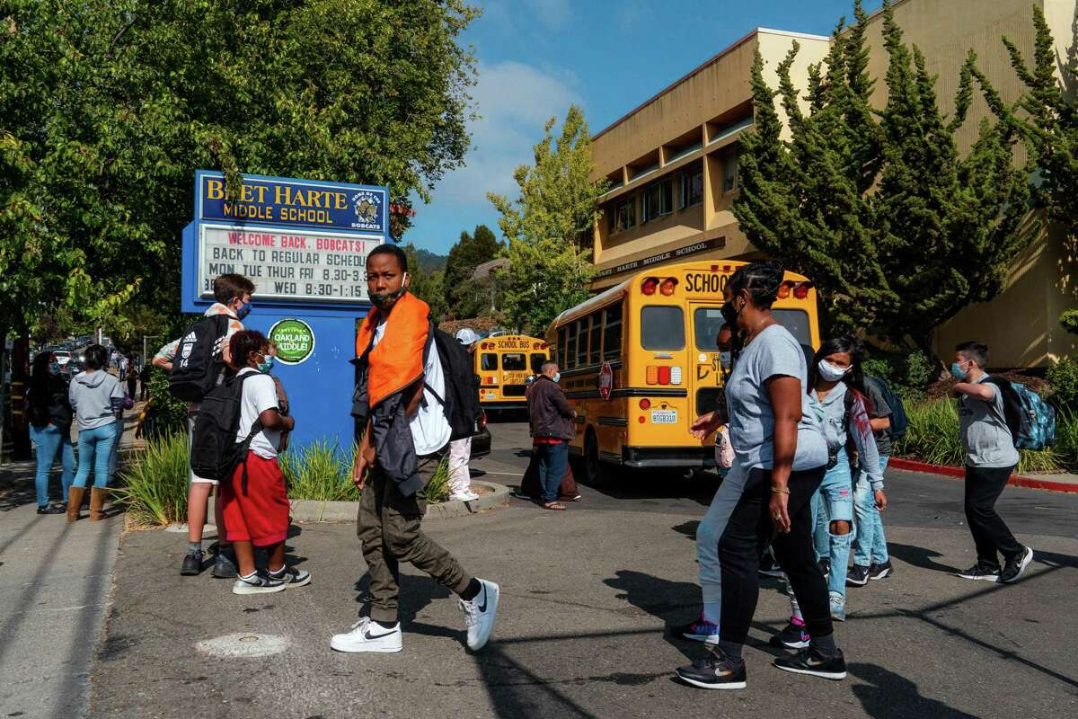 Students leave campus as school lets out at Bret Harte Middle School in Oakland.