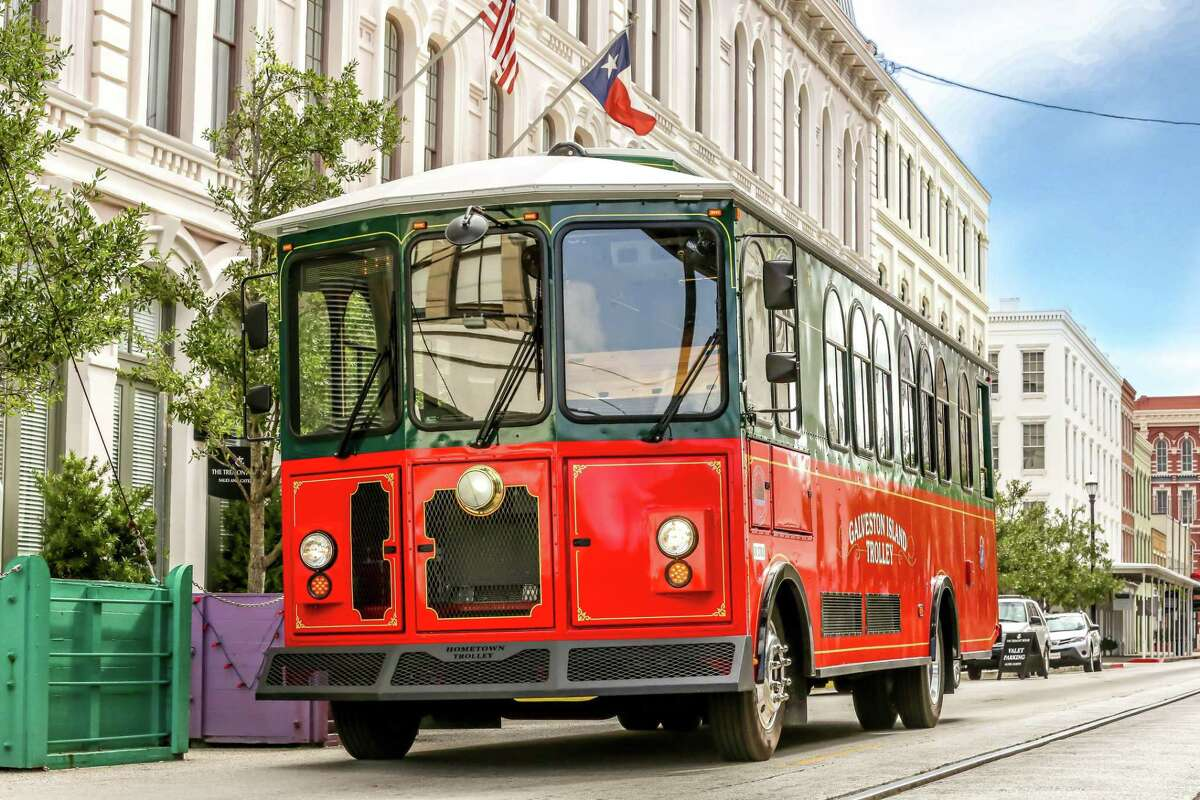 Galveston has been running rubber-wheeled trolleys in downtown Galveston for several years. Here one is shown passing by the Tremont Hotel.