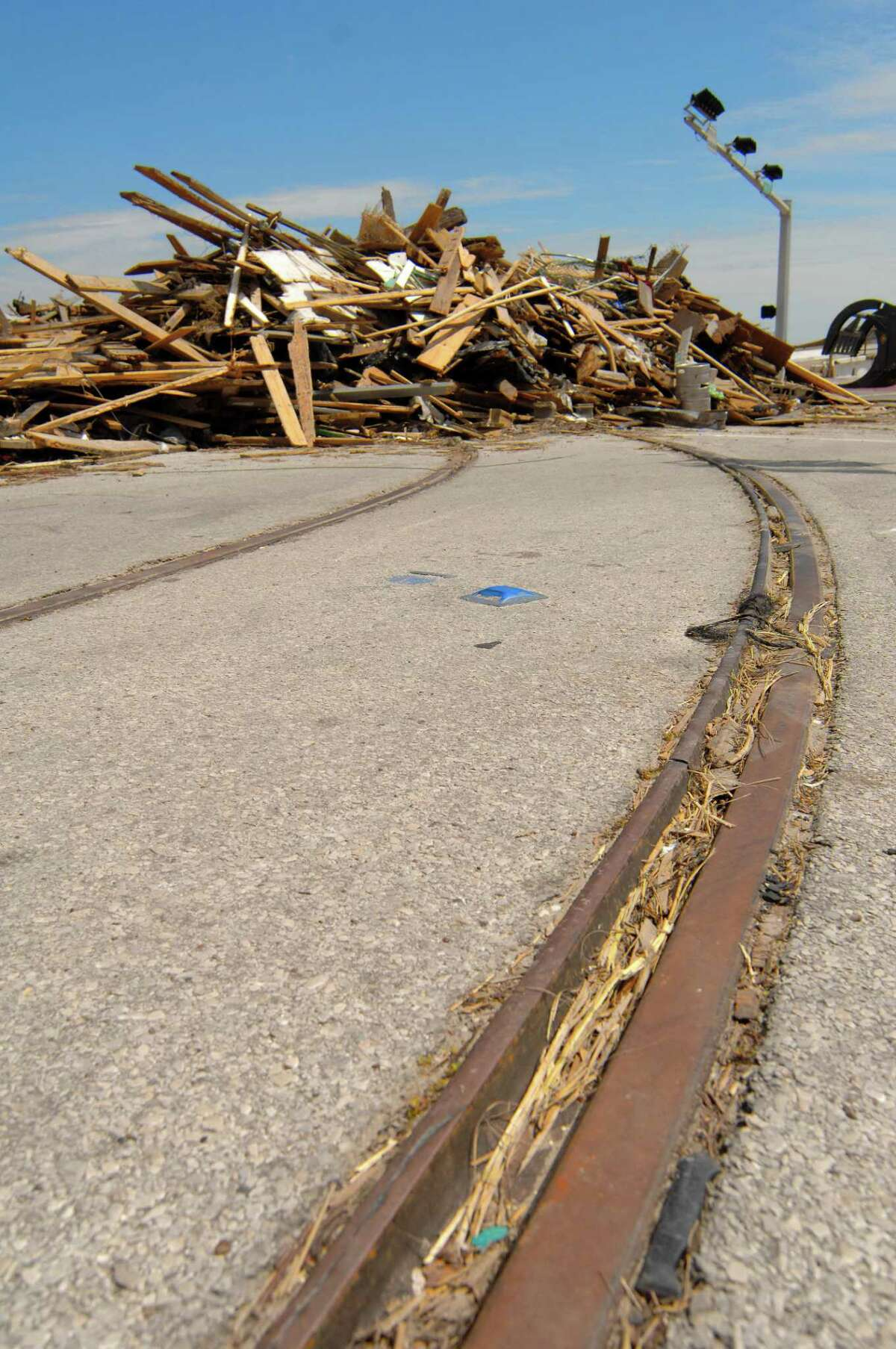 File photo from 2008 shows Galveston trolley tracks leading to the debris of the Balinese Room caused by Hurricane Ike.
