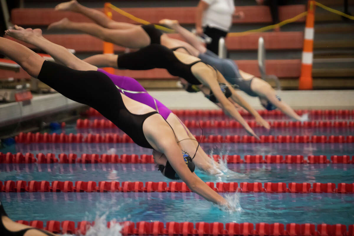 Midland's Alyssa Rentsch competes in the 200 yard freestyle during the 2021 Girls Tri-Cities Championship prelims Thursday, Sept. 23, 2021 at Saginaw Valley State University. (Katy Kildee/kkildee@mdn.net)