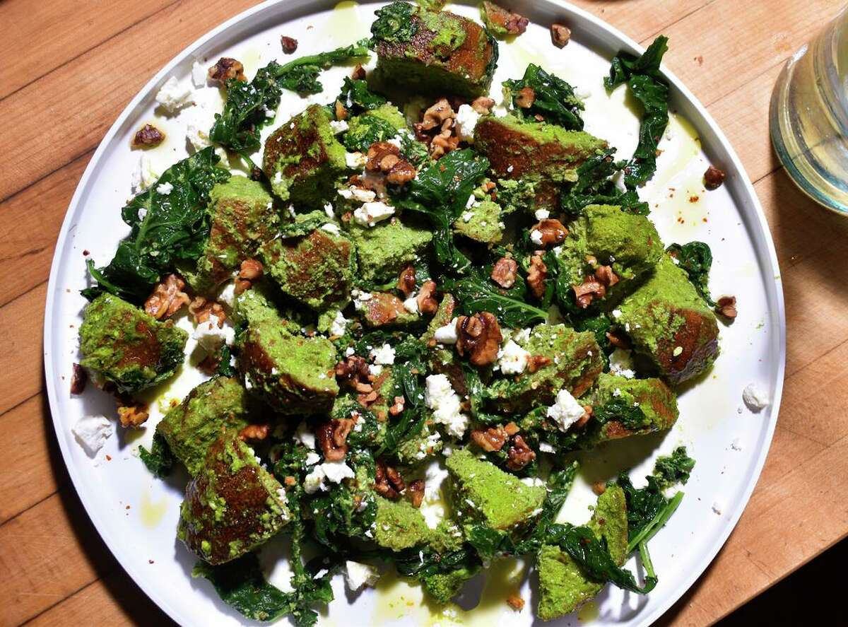 This recipe for Panzanella Verde gets its green color from from broccoli rabe and its creamy richness from feta and roasted walnuts.