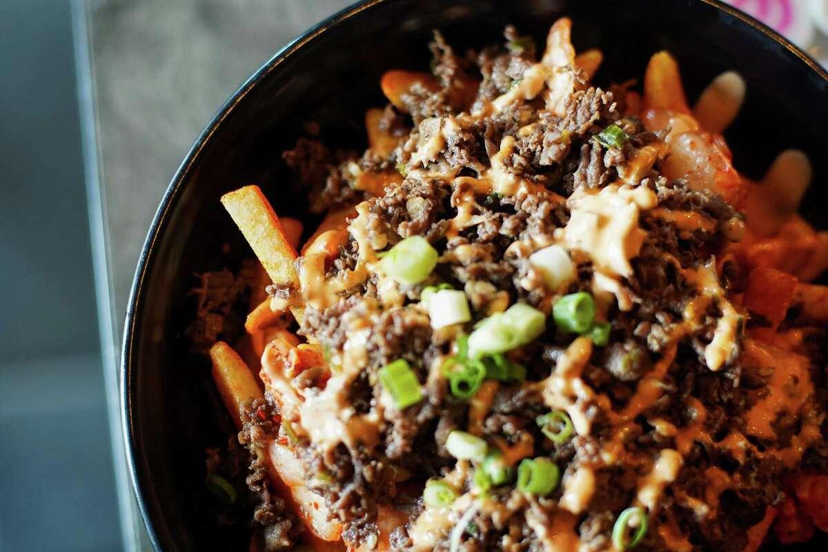Bulgogi beef served on kimchi fries at Shabu House in Houston on Wednesday, Sept. 22, 2021.