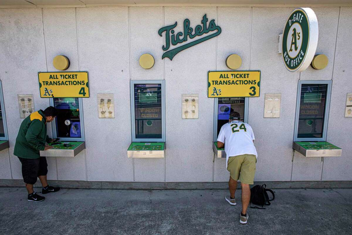 Fans buy tickets for the MLB game between the Oakland Athletics and Los Angeles Angels at the Oakland Coliseum in July.