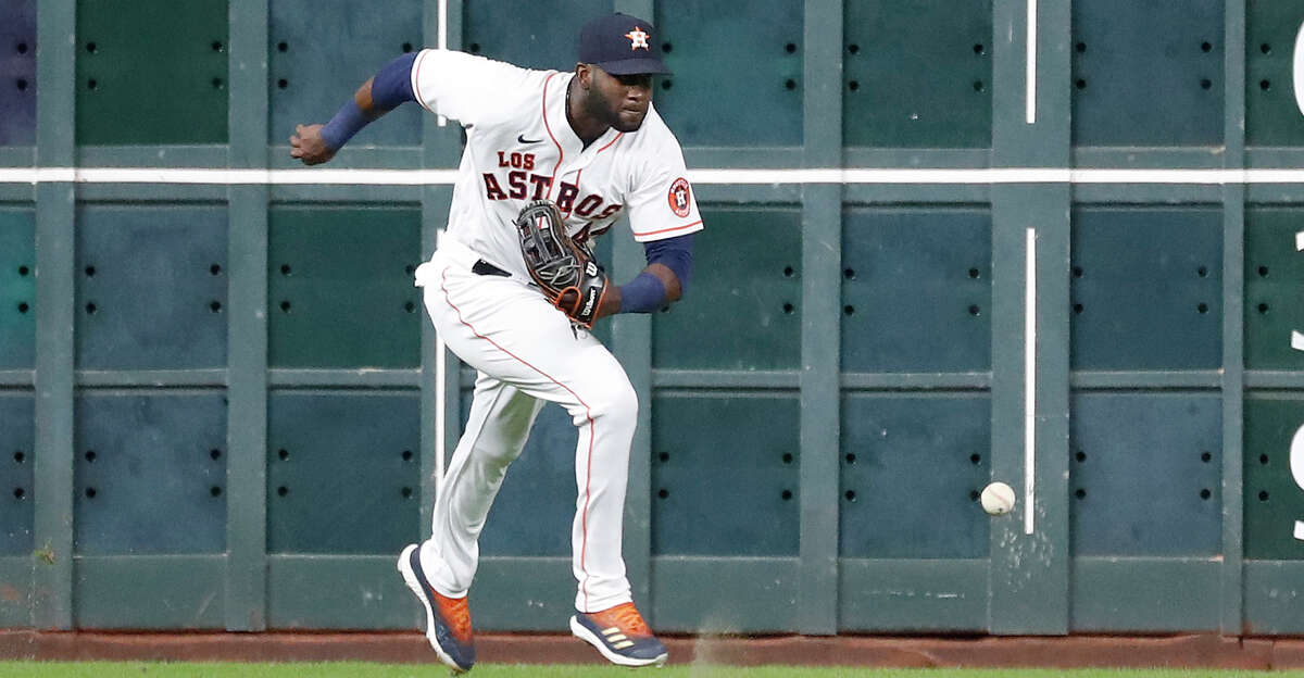Houston Astros left fielder Yordan Alvarez (44) chases Arizona Diamondbacks Jake McCarthy's double during the sixth inning of an MLB baseball game at Minute Maid Park, Saturday, September 18, 2021, in Houston.